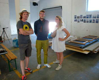 Designer Tristan Cochrane with organizing team members Moritz Walther and Matylda Krzykowski